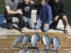 fishers-island-adventures-fishing-clients-on-dock